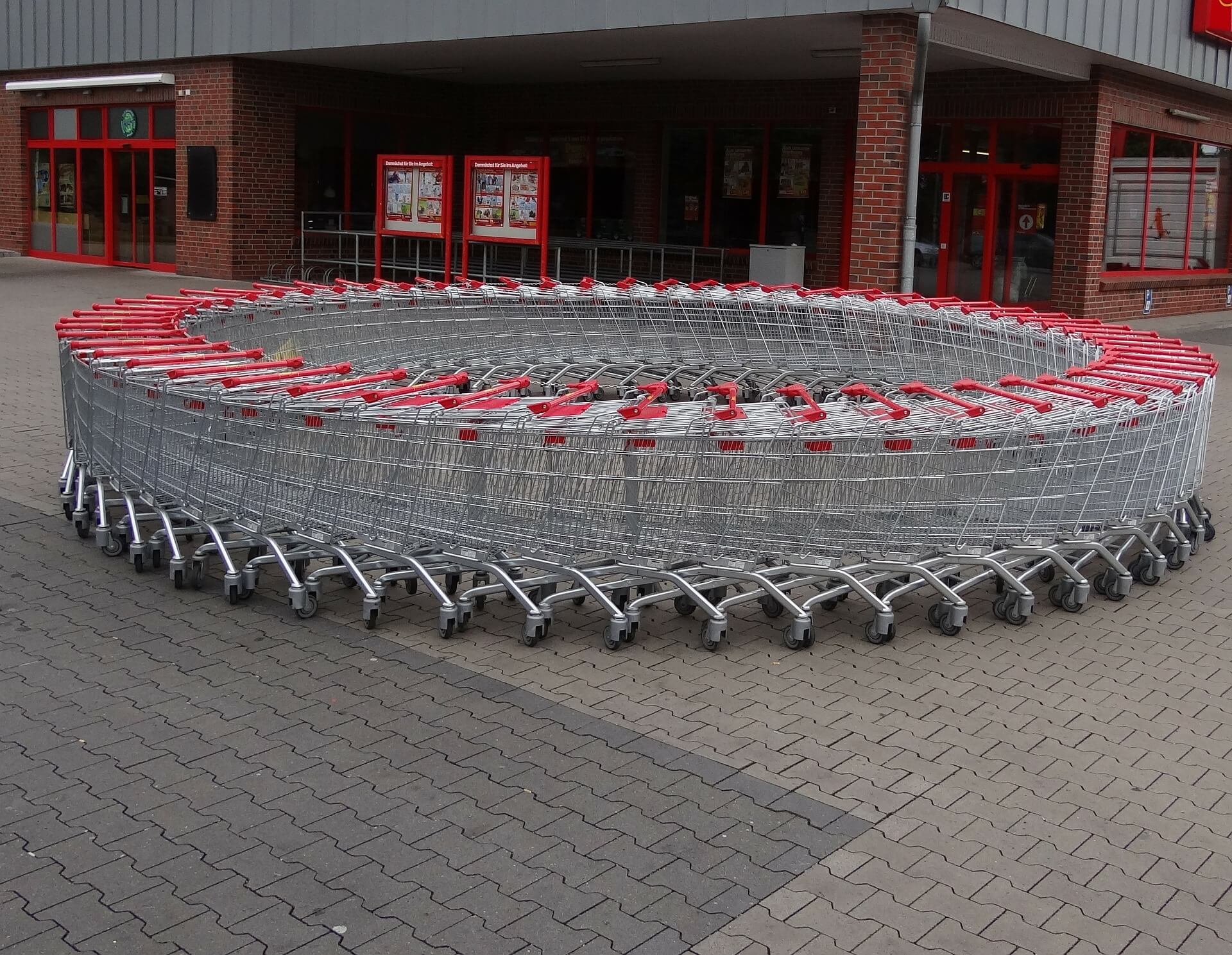 circle of red handled shopping baskets