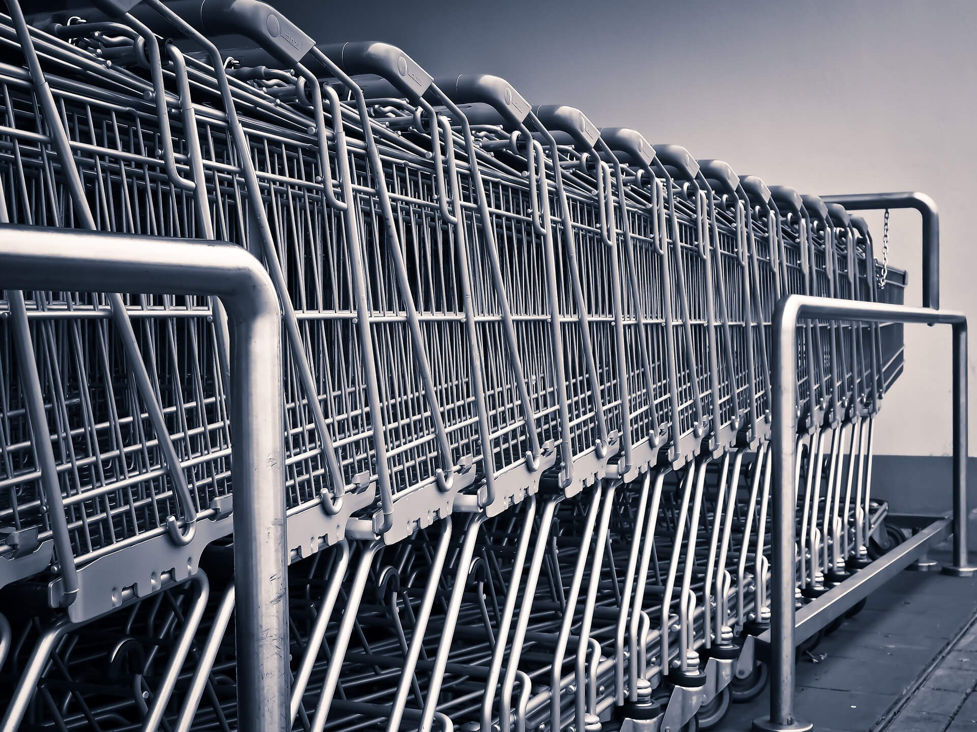stacked row of bright silver shopping carts